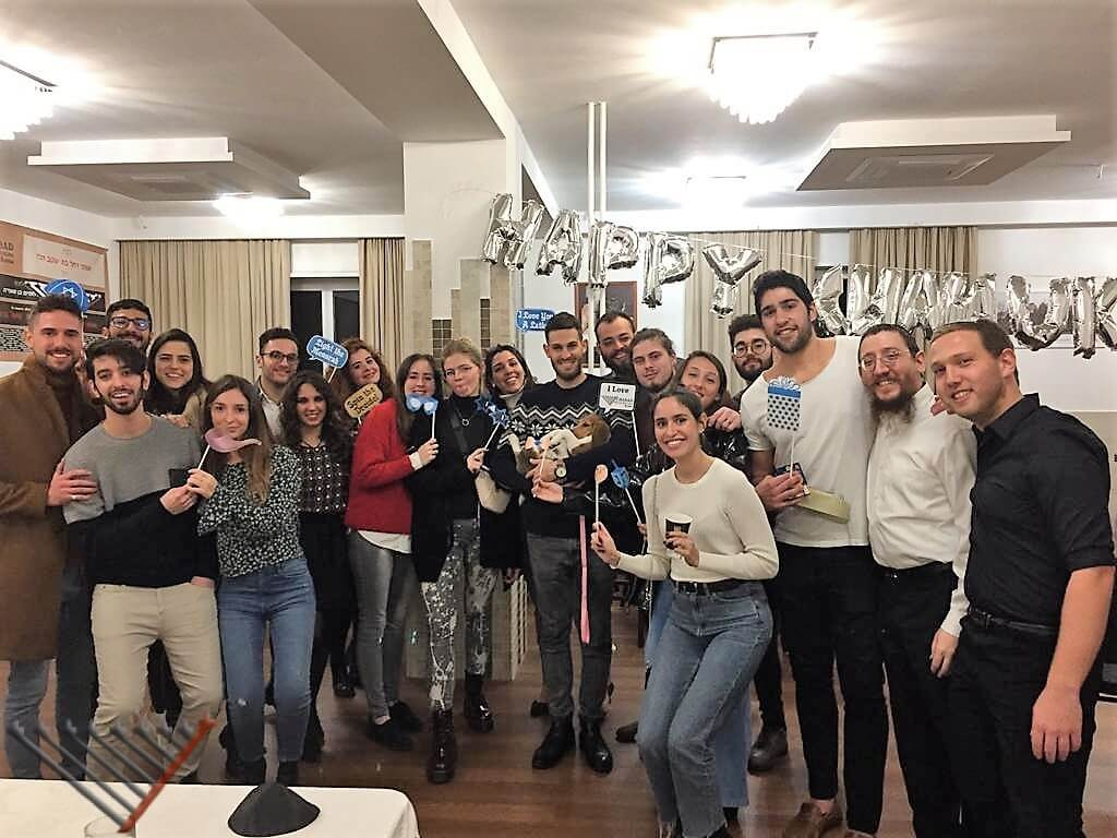 Italians and Foreigners Mingle at Chanukah Party